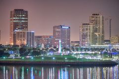SAN DIEGO, CA - JULY 31, 2017: Night reflections of Downtown San Diego from the city port. The city attracts 10 million tourists stock images