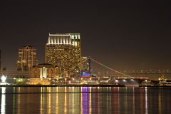 San Diego CA skyline and aircraft carrier Midway. At night across San Diego Bay from Harbor Island Royalty Free Stock Photos