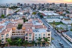 San Diego CA/USA - 01 12 2015: Färgrik solnedgång mot i stadens centrum San Diego Royaltyfri Bild
