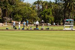 Group of People Play Lawn Bowling in Balboa Park. SAN DIEGO, CALIFORNIA - APRIL 28, 2017:  A group of people playing lawn bowling in Balboa Park, which has the Stock Photo