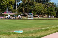 People Play Lawn Bowling on Grass Rinks in Balboa Park. SAN DIEGO, CALIFORNIA - APRIL 28, 2017:  People play lawn bowling on grass rinks in Balboa Park, which Royalty Free Stock Photo