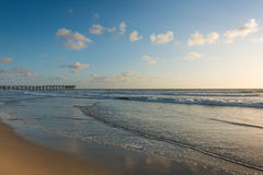 San Diego. California coast. San Diego beach at sunset. Ocean Waves rolled on the sand Stock Photos