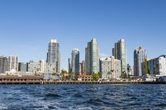 Embarcadero Restaurants and Buildings in San Diego. SAN DIEGO, CALIFORNIA - MARCH 2, 2017: The downtown skyline, with restaurants, apartment buildings, and the stock photography