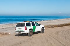 Border Patrol Vehicle Patrols Beach at Border Field State Park in San Diego. SAN DIEGO, CALIFORNIA - NOVEMBER 4, 2017: A Border Patrol vehicle patrols the beach stock photos