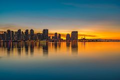 SAN DIEGO, CALIFORNIA SUNSET WITH COLORFUL SKY. SAN DIEGO, CA SUNRISE SUNSET WITH COLORFUL SKY, DOWNTOWN BUILDINGS, REFLECTING WATER stock image