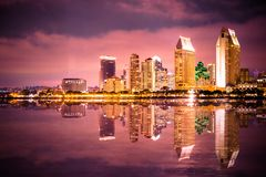 San Diego California sunset Skyline colorful. Beautiful night skyline of San Diego California with bay of water and lit buildings royalty free stock photography