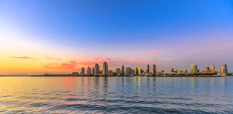 San Diego cityscape sunset. Scenic landscape with sunset colors sky of San Diego skyline with skyscrapers in San Diego Bay. Districts of Waterfront Marina stock photography