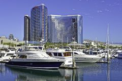 SAN DIEGO, CLAIFORNIA USA - NOVEMBER 5, 2017: Luxury yachts in Embarcadero Marina near Seaport Village in San Diego Bay with the S. An Diego skyline and the royalty free stock photos