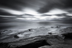 San Diego Coast in black and white. Cliffside picture of the pacific ocean in San Diego, California in black and white stock image