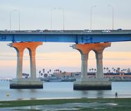 San Diego - Coronado Bridge. Dwarfs fisherman standing below Royalty Free Stock Photo