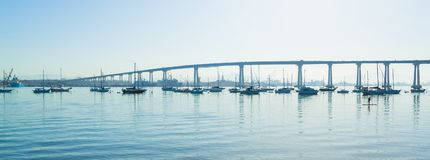San Diego Coronado Bridge. San Diego waterfront with sailing Boats - Industrial harbor and Coronado Bridge stock images