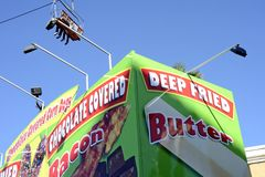 San Diego County Fair Scene. SAN DIEGO, CA -  JULY 2011:  Deep Fried Butter sign from the San Diego County Fair, formally called the Del Mar Fair on July 1, 2011 Stock Photo