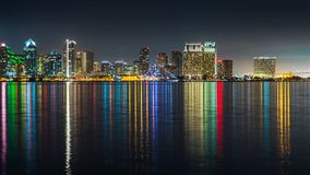 San Diego dowtown skyline, night water reflections. San Diego skyline, night, water reflections. Downtown cityscape with buildings reflecting, City of San Diego royalty free stock images