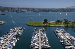 San Diego Harbor. Boats docked within San Diego Harbor in sunny california with Coronado Island in the background stock image