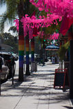 San Diego Hillcrest Gay Pride 2017 Decorations. Rainbow Flags on Palm Trees and Flamingos. Decorations outside of Urban Mo`s, a cafe in Hillcrest, San Diego stock images