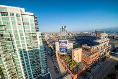 SAN DIEGO - JULY 29, 2017: Petco Park and Coronado Bridge on background. San Diego attracts 20 million people annually royalty free stock photo