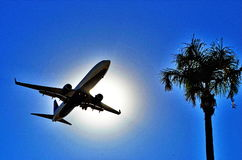 San Diego Landing. Silhouetted airliner landing in San Diego Stock Photo