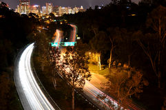 San Diego Light Trails. Slow-shutter traffic light trails on the 163 freeway in San Diego. Photo taken from Cabrillo Bridge in Balboa Park Royalty Free Stock Photo