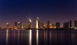 San Diego lights panorama 2. San Diego downtown skyline after dusk, from Coronado Island stock photos