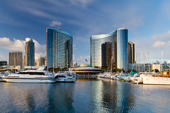 San Diego marina. Scenic view of boats moored in San Diego marina with skyscrapers in background, California, U.S.A royalty free stock image
