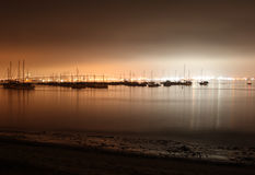 San Diego Marina at night. Night time long exposure of sailboats moored in a calm San Diego Bay with the Coronado Bay Bridge lit up brightly in the background Royalty Free Stock Photo