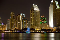 San Diego at night. Downtown San Diego at night. Boats on the bay decorated with lights show motion blur stock photos