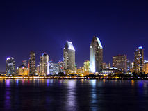 San Diego night skyline. San Diego skyline as taken from the Coronado Ferry dock.  Colorful reflections dapple the San Diego bay Royalty Free Stock Photos
