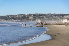 San Diego - November 1, 2015: People walking along the shore of Mission Beach in San Diego, California Stock Photography