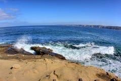 San diego rocky beach. La jolla san diego coastline.  Waves hitting the rocks Stock Photos