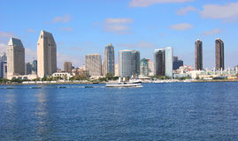 San Diego Skyline. A San Diego Skyline and a boat passing by Royalty Free Stock Photography