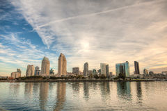 San Diego Skyline. Skyline of San Diego, California on a bright sunny day with building reflections in the water and a cloudy sky stock photos