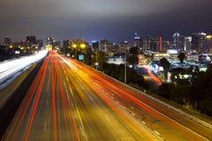 San Diego Skyline, Freeway. Long exposure of freeway and city skyline of San Diego, California royalty free stock image