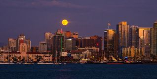 San Diego Skyline Full Moon, California. The downtown skyline of San Diego, as seen from the bay, at sunset with a full moon rising royalty free stock photo