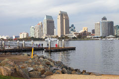 San Diego skyline & marina. A view of San Diego skyline and tourists on a dock looking over Stock Photo