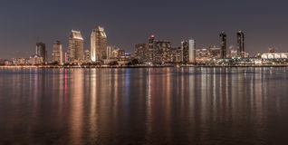 San Diego Skyline at night with water reflections. San Diego Skyline at night. View from Coronado Island stock image
