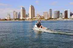 San Diego Skyline and a patrol boat. A San Diego skyline and a patrol boat in the bay Royalty Free Stock Images