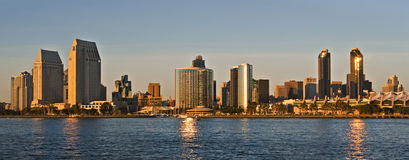 San Diego Skyline at Sunset. The skyline of the tall buildings of downtown San Diego, a major tourist destination in southern California, reflected on San Diego stock images