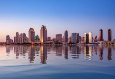 San Diego Skyline at sunset from Coronado. Sunset illuminating the tall skyscrapers of San Diego in California from Centennial Park in Coronado with artificial stock photo