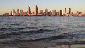 The San Diego Skyline. Sunset over the San Diego skyline across San Diego Bay from Coronado Island stock video