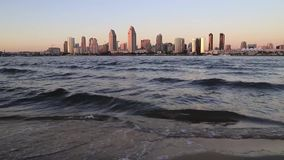 The San Diego Skyline. Sunset over the San Diego skyline across San Diego Bay from Coronado Island stock video footage
