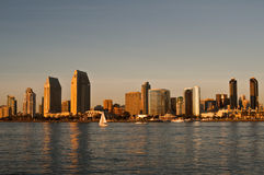 San Diego Skyline at Sunset with Sailboat. The skyline of the tall buildings of downtown  San Diego, a major tourist destination in southern California Stock Photos