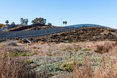 San Diego/Tijuana International Border Wall on Hillside in San Diego. A portion of the international border wall between San Diego, California and Tijuana Royalty Free Stock Images