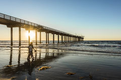San Diego, USA - November 7, 2015: Couple walking by Scripps Pier during sunset in La Jolla, San Diego, California Stock Image