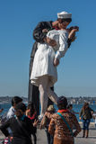 SAN DIEGO, USA - NOVEMBER 14, 2015 - People taking a selfie at sailor and nurse while kissing statue san diego Royalty Free Stock Photo