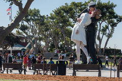 SAN DIEGO, USA - NOVEMBER 14, 2015 - People taking a selfie at sailor and nurse while kissing statue san diego Royalty Free Stock Images
