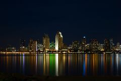 San Diego waterfront by night. Night San Diego waterfront skyline with colorful lights reflecting from the water royalty free stock photos