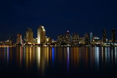 San Diego waterfront by night. Night San Diego waterfront skyline with colorful lights reflecting from the water royalty free stock images