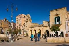 Piazza Vittorio Veneto. Matera. Basilicata. Apulia or Puglia. Italy. San Domenico church to the left, arches of the cistern Palombaro Lungo and Mater Domini royalty free stock images