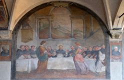 San Dominic in Mensa fed by the Angels, fresco in Santa Maria Novella church in Florence. San Dominic in Mensa fed by the Angels, fresco by Santi di Tito in the stock photo