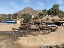 San Felipe abandoned boats. Time weathers all things along the Sea Cortez, San Felipe. These boats have been sitting here for at least 20 years they are starting Royalty Free Stock Photography